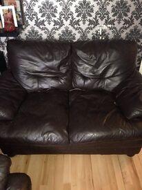 Dark brown 2 seater sofa
