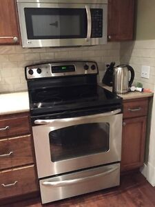 GE stainless steel oven stove with LG microwave excellent condit