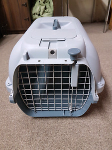 Dogit brand pet travel crate with small storage spots