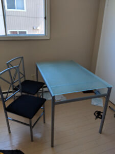 Glass table top and 2 chairs.