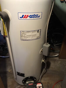 Hot water tank with oil burner for sale.