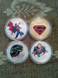 4 SUPERMAN 1938 RENDITION SILVER AND GOLD PLATED COINS.