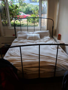 Queen mattress and black bed frame