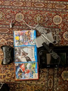 Nintendo Wii U console with controllers and games