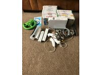 Wii Games console plus games/controllers/drums/guitars/ balance board