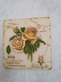 A pair of decorative picture tiles