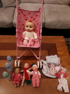 Baby Alive, Stroller, Bottles, Clothes and 3 extra babies.