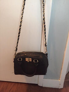 Black purse with gold accent