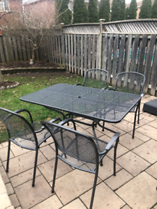 black metal mesh patio table and four chairs