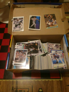 A box full of Hockey baseball and basketball cards