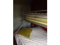 Double Single metal frame bunk bed in good condition - mattresses not included