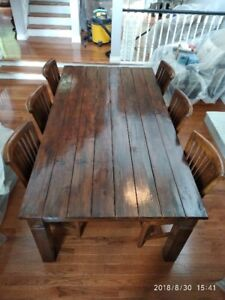 MUST BE SOLD! Solid wood dining table and 8 matching chairs