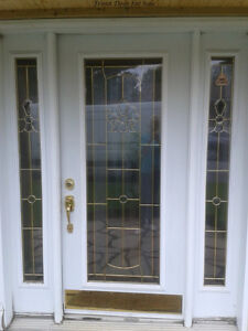 Front Door with glass inserts in its frame