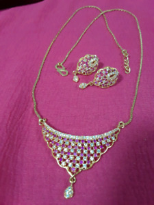 Gold plate set with pink and white stones