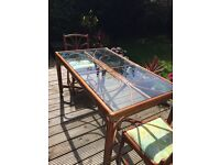 Rattan wooden dining table glass top and four chairs