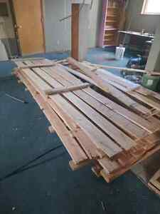 5 wooden pallets roughly 10 feet long