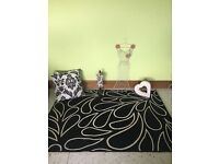 Black and cream rug, metal wall art, large heart ornament, 2 cushions