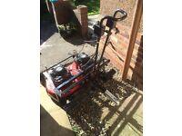Tow behind lawn mower petrol