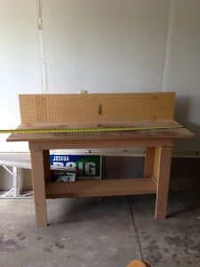 Solid workbench with pegboard