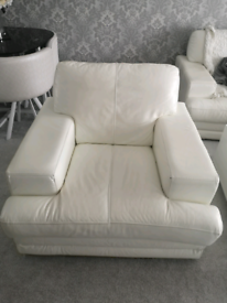 White DFS leather armchair.