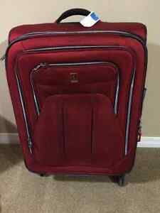 Large Travelpro Red Suitcase