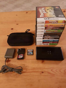 Nintendo DS lite + 11 games, case, and action replay