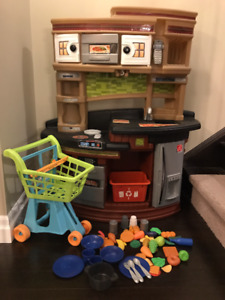 Modern Step 2 play kitchen with shopping cart