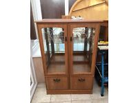 Glass display cabinet with glass shelf, double doors and a double cupboard at the bottom & lighting