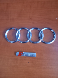 Audi ring badge and S line badge.