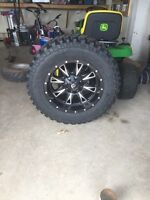 "Brand new 20"" fuel rims and 35"" Firestones"