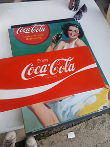 Antique dry mounted coke signs