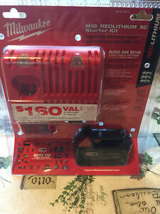 M18 Battery Charger and XC 3.0AH Battery Pack New $150 Stratford Kitchener Area image 1