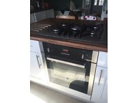 Electric oven and gas 5 burner hob.