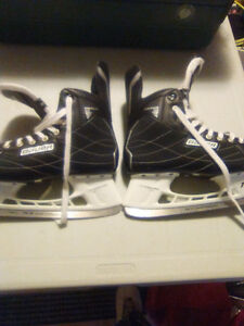 Have two pairs of hockey skates. Also, another pair of skates.