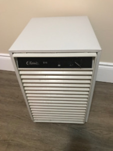 Dehumidifier with detachable hose and basin