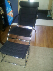 Modern chair with footrest