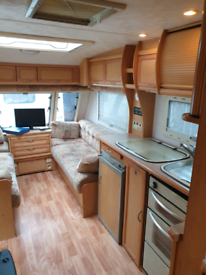 2005 COMPASS OMEGA 534 FIXED BED