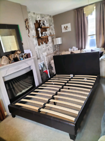 Dark brown faux leather double bed feel free to contact me