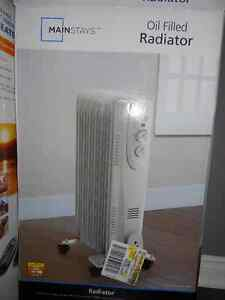 Two Mainstay oil filled radiators - only used this winter
