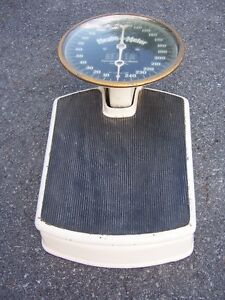 Antique set of doctors office, bathroom scales