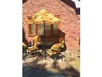 Glass Top Garden Table and Chair set including Cushions and Matching Parasol