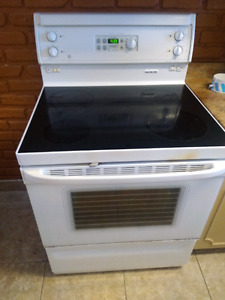 White glass top convection oven stove. Self clean.
