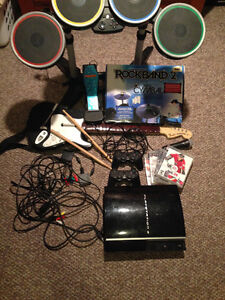 PS3 with 2 controllers, 4 games and Rock Band