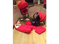 Stokke V3 plus accessories in red