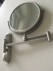 Magnifying wall mounted mirrors