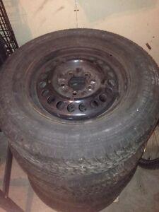4 Worn all Season Tires w/ Rims