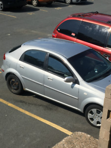 Selling my silver 2006 Chevy Optra hatchback! ONLY 151000 KMS!!