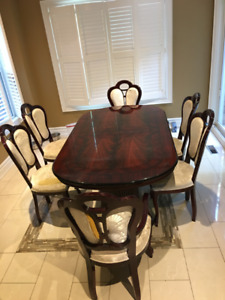 Solid Cherrywood table. 6 chairs needing reupholstering optional