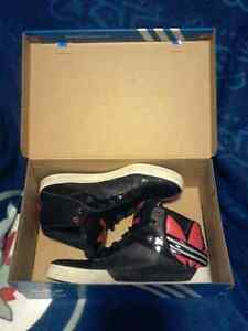 Black and red Adidas shoes with box