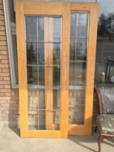 Two Solid Oak French Doors $150 each.